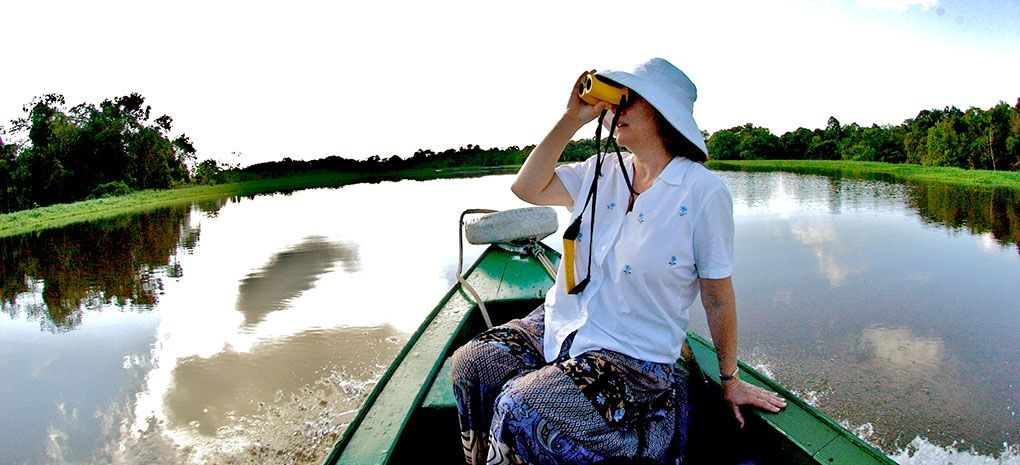 Amazon River Cruise Passenger with Binoculars