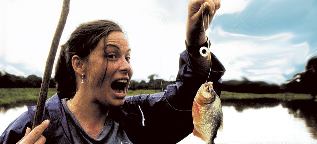 Woman Catches Piranha on Amazon River Cruise