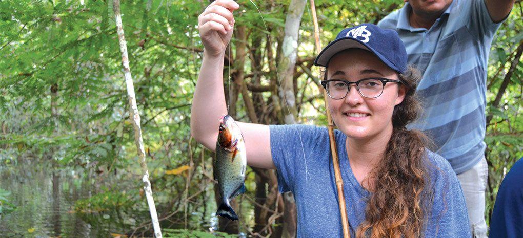 Girl Catches Piranaha on Amazon River Cruise