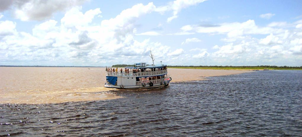 Motor Yacht Tucano Sailing the Encontro das Aguas on an Amazon River Cruise